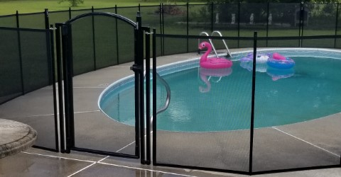 100 ft pool fence with arched gate installed in Biloxi, MS