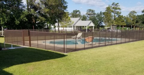 150 ft brown pool fence instaleld in Franklin, Louisiana