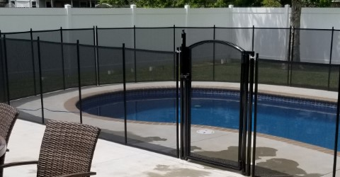 Life Saver mesh pool fence installed with a self-closing gate in Gulfport, MS